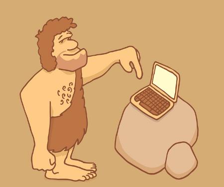 Cartoon caveman using a laptop