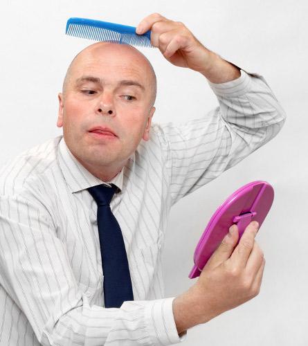 Narcissistic bald man combing his head