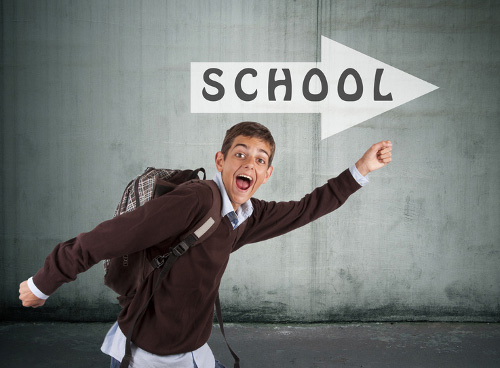 Excited boy heading back to school