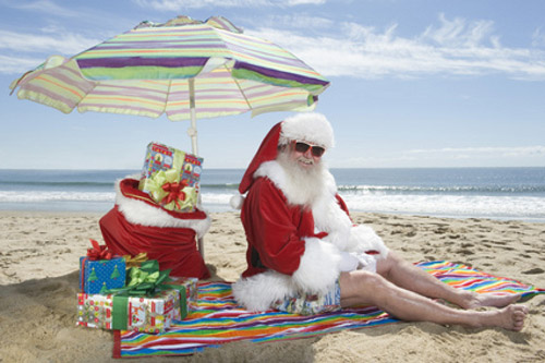 Santa Clause lounging on the beach