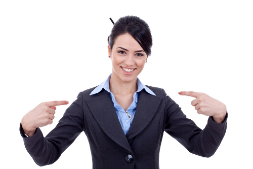 Business woman pointing to herself