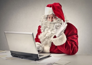 Santa Clause working on laptop