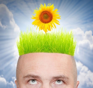 Spring flower growing out of man's head