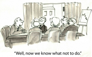 Cartoon image of a meeting with text: 'Well now we know what not to do.'